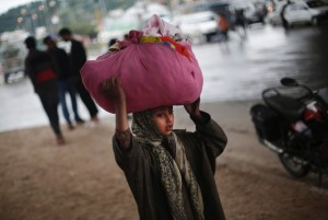 A Kashmiri girl arrives at a free medical camp for displaced people, after the worst flood in the region in a century. Image by Adnan Abidi/Reuters