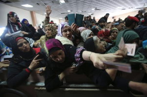 Women show their passports at the Egypt-Gaza border crossing at Rafah, which opened last Sunday for the first time in two months. Image by Ibraheem Abu Mustafa/Reuters