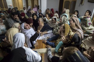 Women mourn the death of 15-year-old Mohammed Ali Khan, one of the over 160 killed during a brutal attack on a school in Peshawar, Pakistan. Image by Zohra Bensemra/Reuters