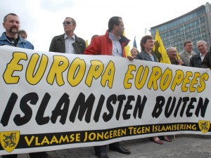 "A nationalist group in Belgium holds a sign that reads: ""Europe for Europeans, Islamization out."" [Source]"