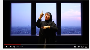 Screenshot of a woman reciting the Fatiha in American Sign Language. Via YouTube.