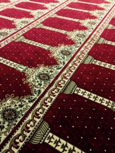 The carpet in the mosque there the author's family prays.